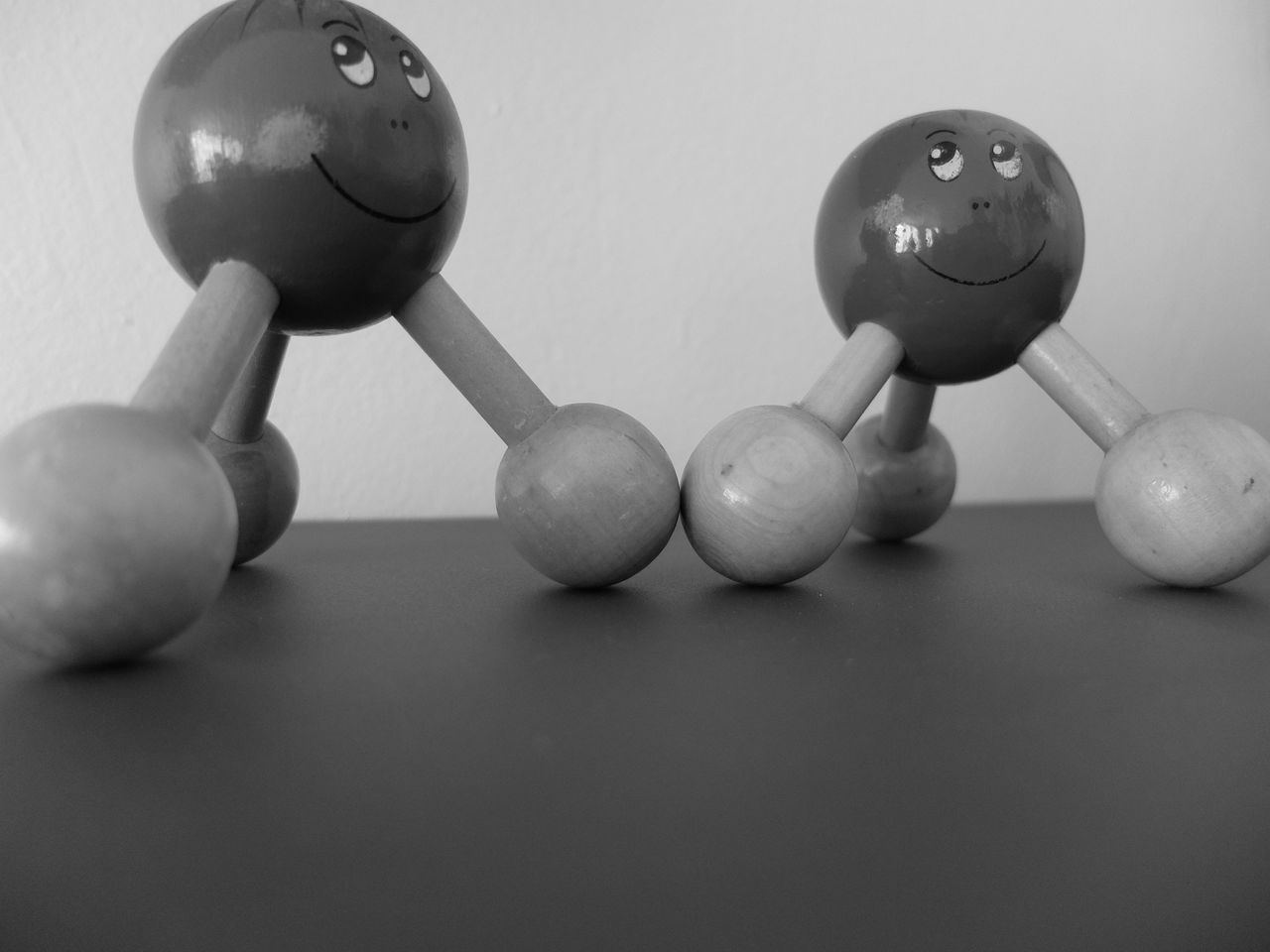 Close-Up Of Atom Toys On Table