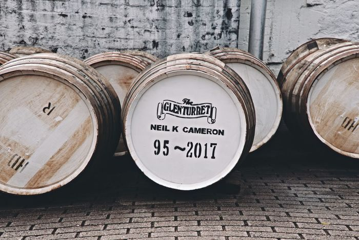 Whisky casks Text Western Script Whisky The Famous Grouse Distillery Crieff Glenturret Perthshire Scotland Casks Whisky Cask Communication No People Day Stack Close-up