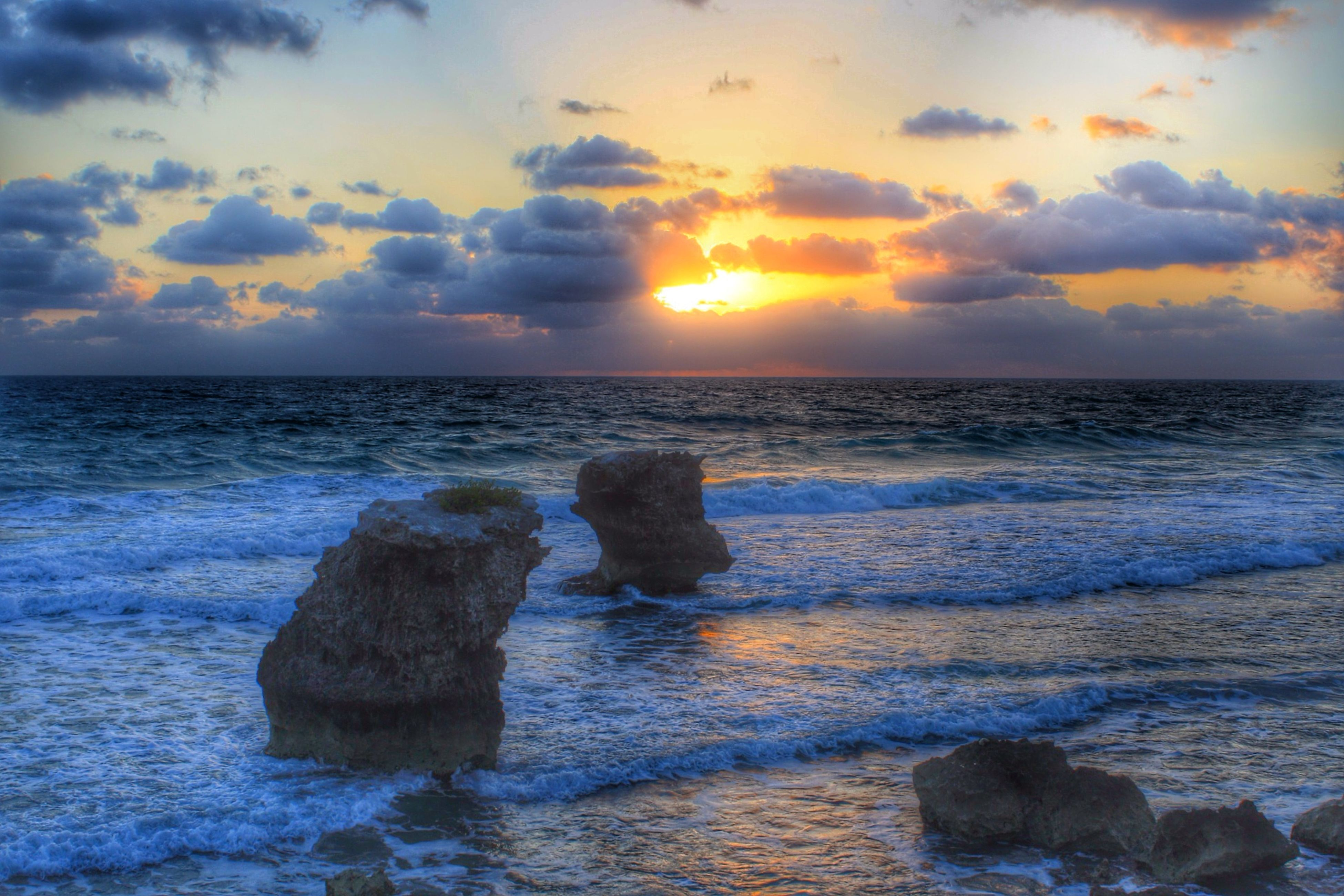 sea, horizon over water, water, sunset, scenics, sky, beauty in nature, tranquil scene, rock - object, tranquility, beach, nature, idyllic, shore, cloud - sky, wave, sun, rock formation, orange color, cloud