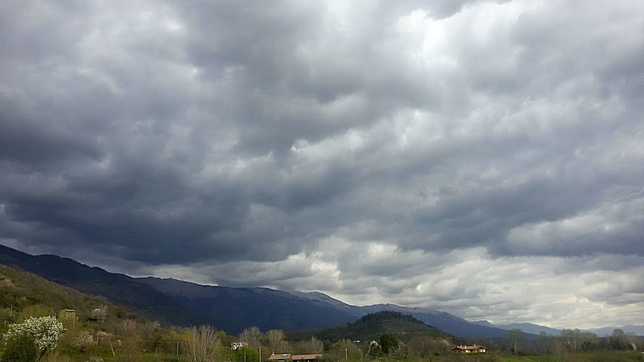 mountain, cloud - sky, nature, weather, sky, beauty in nature, scenics, landscape, tranquility, no people, day, outdoors