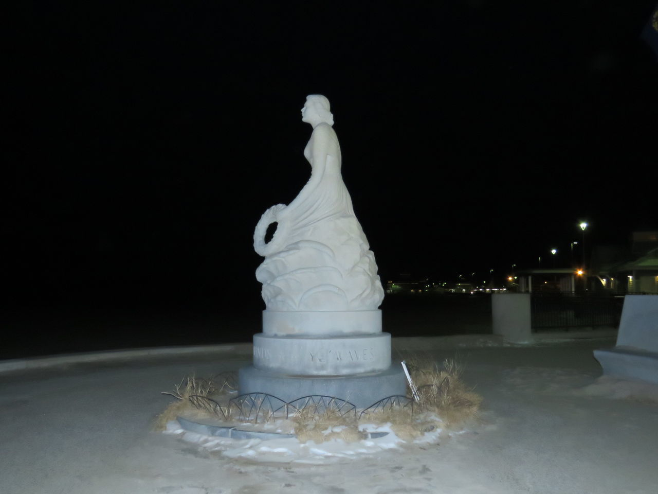 Woman waiting for her husband to come home from the sea Black Background City Lights By Night Close-up Hampton Beach Human Representation Men Lost At Sea Nighttime Photography No People Sea The City Light Widow Woman Statue