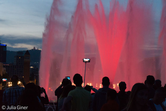 This a typical scence in Montjuic, Barcelona. All tourists, and also locals, with a phone or a camera in hand. Everybody trying to collect that moment of beuaty that they are seeing. And listening too, as while the fountain changes its colors, a song can be heard matching the rythm. Colored Water Internet Generation Mobile In Hand Monjuic Fountain The Photojournalist - 2016 EyeEm Awards Tourism