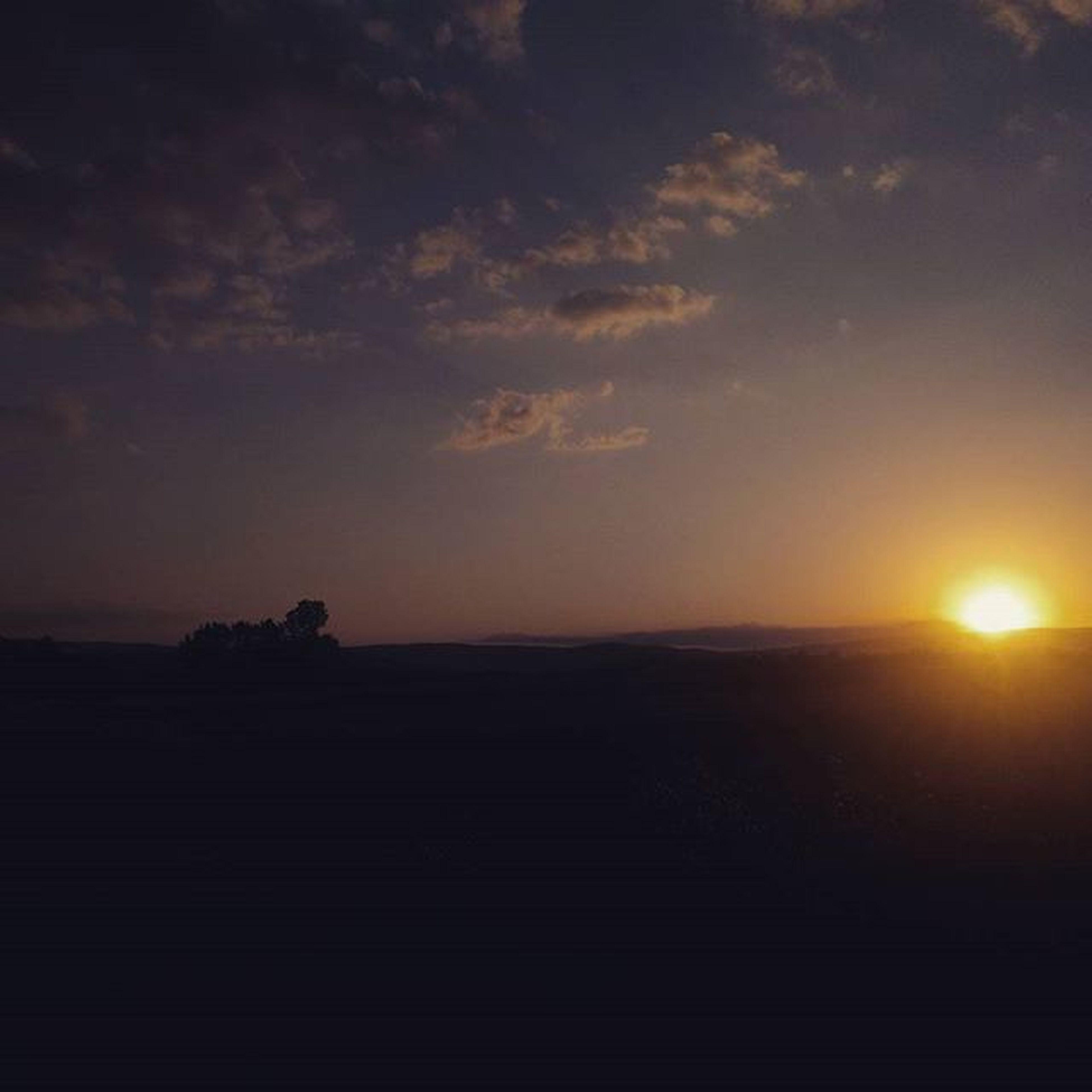 sunset, silhouette, sky, scenics, tranquil scene, sun, beauty in nature, tranquility, cloud - sky, orange color, landscape, nature, idyllic, dark, cloud, sunlight, dramatic sky, sunbeam, cloudy, outdoors