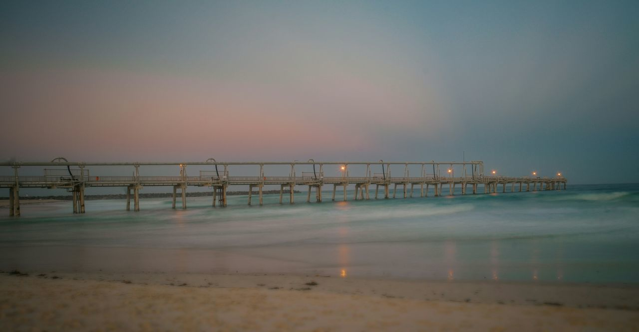 sea, water, beach, sky, nature, sunset, outdoors, scenics, no people, sand, tranquility, beauty in nature, horizon over water, night, architecture, wave