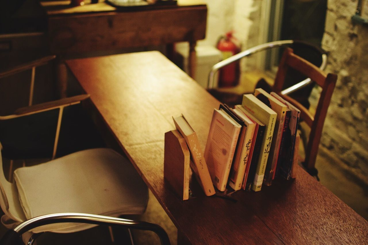book, table, indoors, wood - material, no people, high angle view, education, focus on foreground, desk, close-up, paper, day