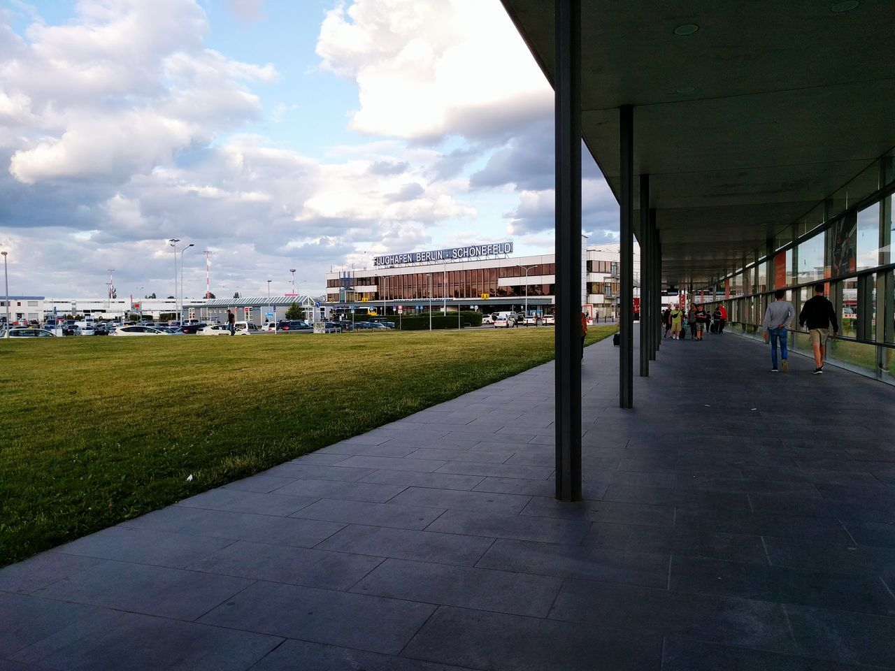 architecture, built structure, sky, cloud - sky, building exterior, day, outdoors, real people, grass, nature, city