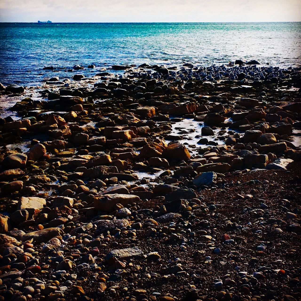 sea, water, pebble, horizon over water, nature, pebble beach, shore, beach, beauty in nature, tranquil scene, tranquility, no people, scenics, rock - object, outdoors, day, sky