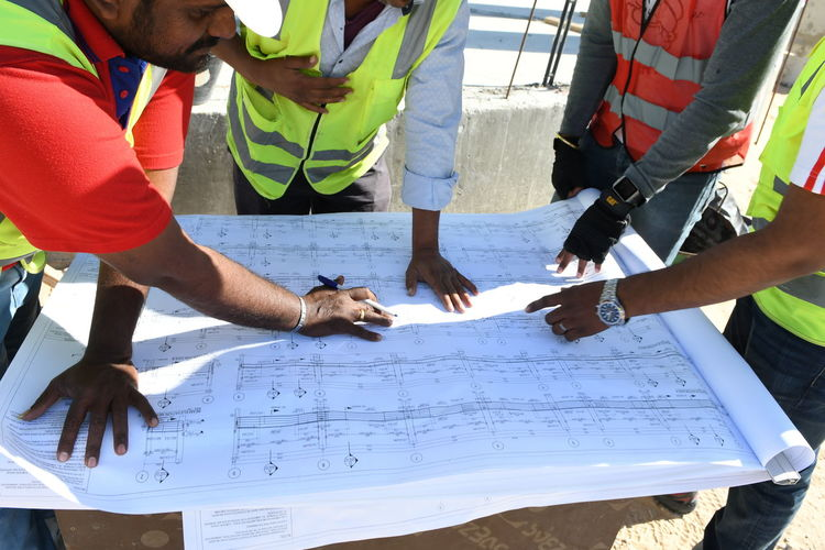Indian engineers are reviewing the construction drawings and blueprints at the construction site Construction Construction Site Hands Hands At Work Indian Culture  Indian Handsome Sam Male Photographer Men At Work  Blueprints Building Civil Engineering Civilengineering Day Drawings Engineer Engineering Foremen Human Hand Male Likeness Male Model Men Men Working Paper People Real People
