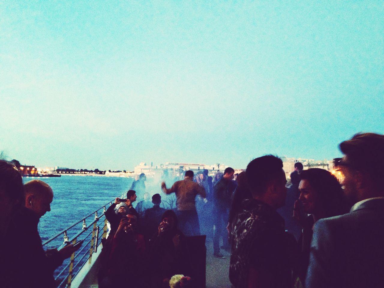 People Enjoying In Party At Seaside