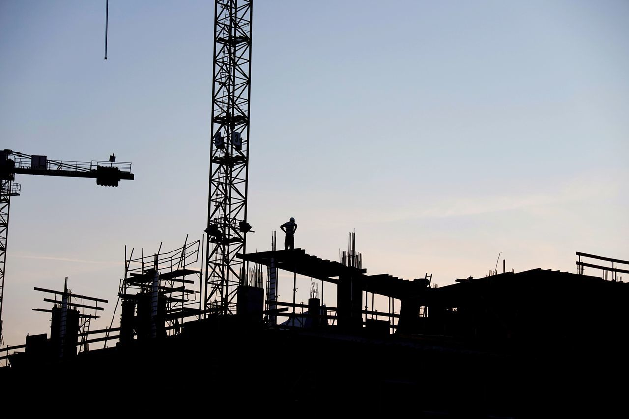 Silhouette Business Finance And Industry Built Structure Outdoors Construction Site Worker Steel Fundation Building High Contrast One Man Looking Crane