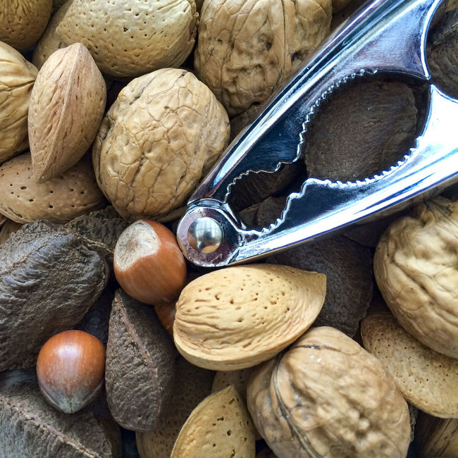 Mixed nuts and nut crackers Abundance Almonds Brazil Nut Brown Choice Christmas Close-up Detail Directly Above Food Food And Drink Hazel Nuts Healthy Eating Large Group Of Objects Nut Nut Crackers Nuts Seeds Shells Still Life Walnuts