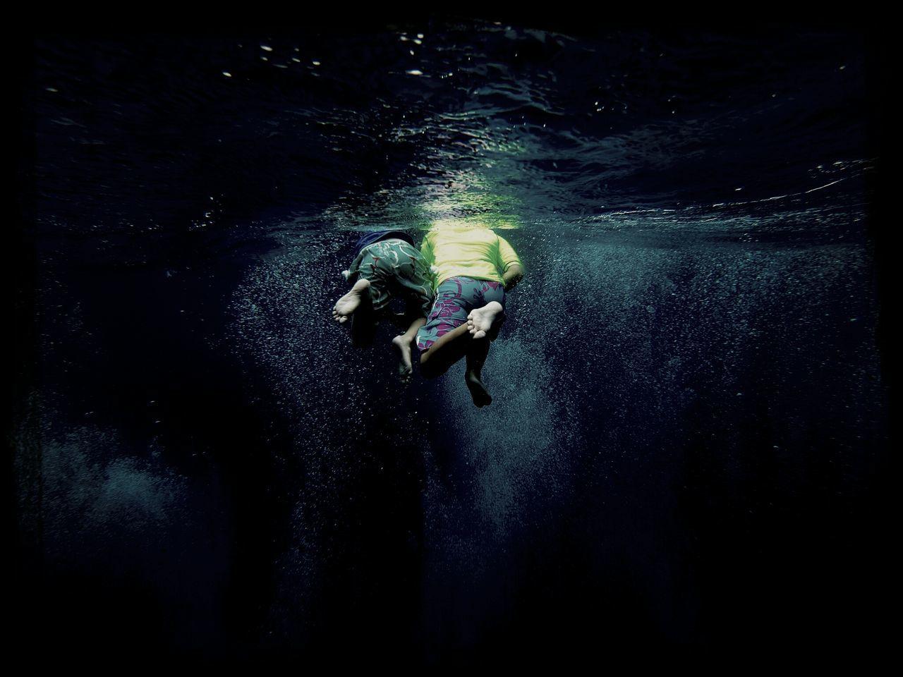 Two Men Swimming