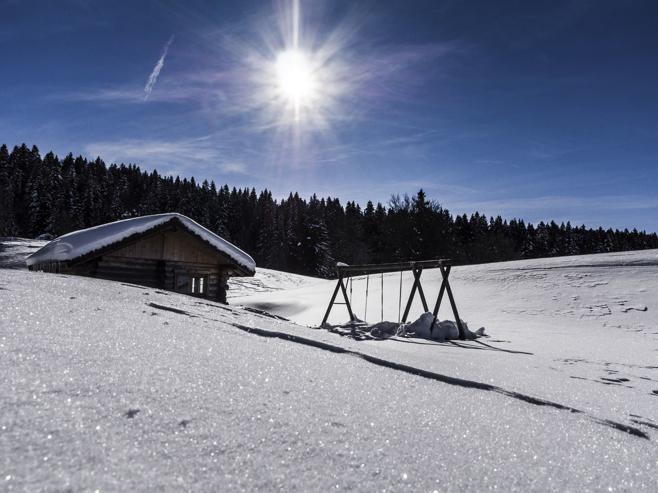 Beauty In Nature Cabin Chalet Cold Temperature Day The Great Outdoors - 2017 EyeEm Awards Landscape Landscape_Collection Lens Flare Nature Nature_collection No People Outdoors Scenics Seesaw Sky Snow Sun Sunbeam Sunlight Swing Tranquil Scene Tranquility Tree Winter
