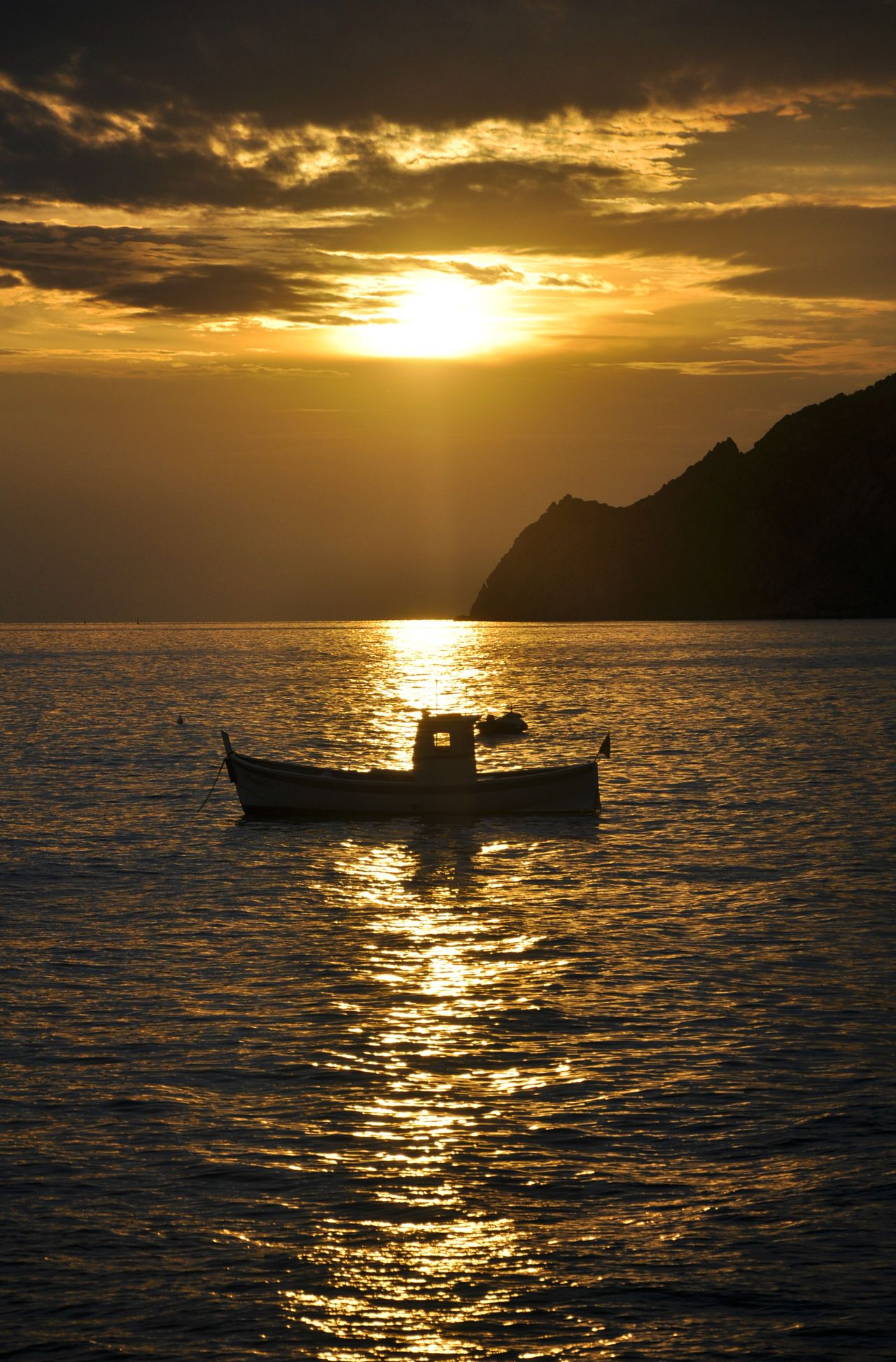 Beauty In Nature Boat Nature Nautical Vessel No People Outdoors Sea Sky Sunset Travel Destinations Water Loneliness Lonely Boat Lonely Object Calm Sea