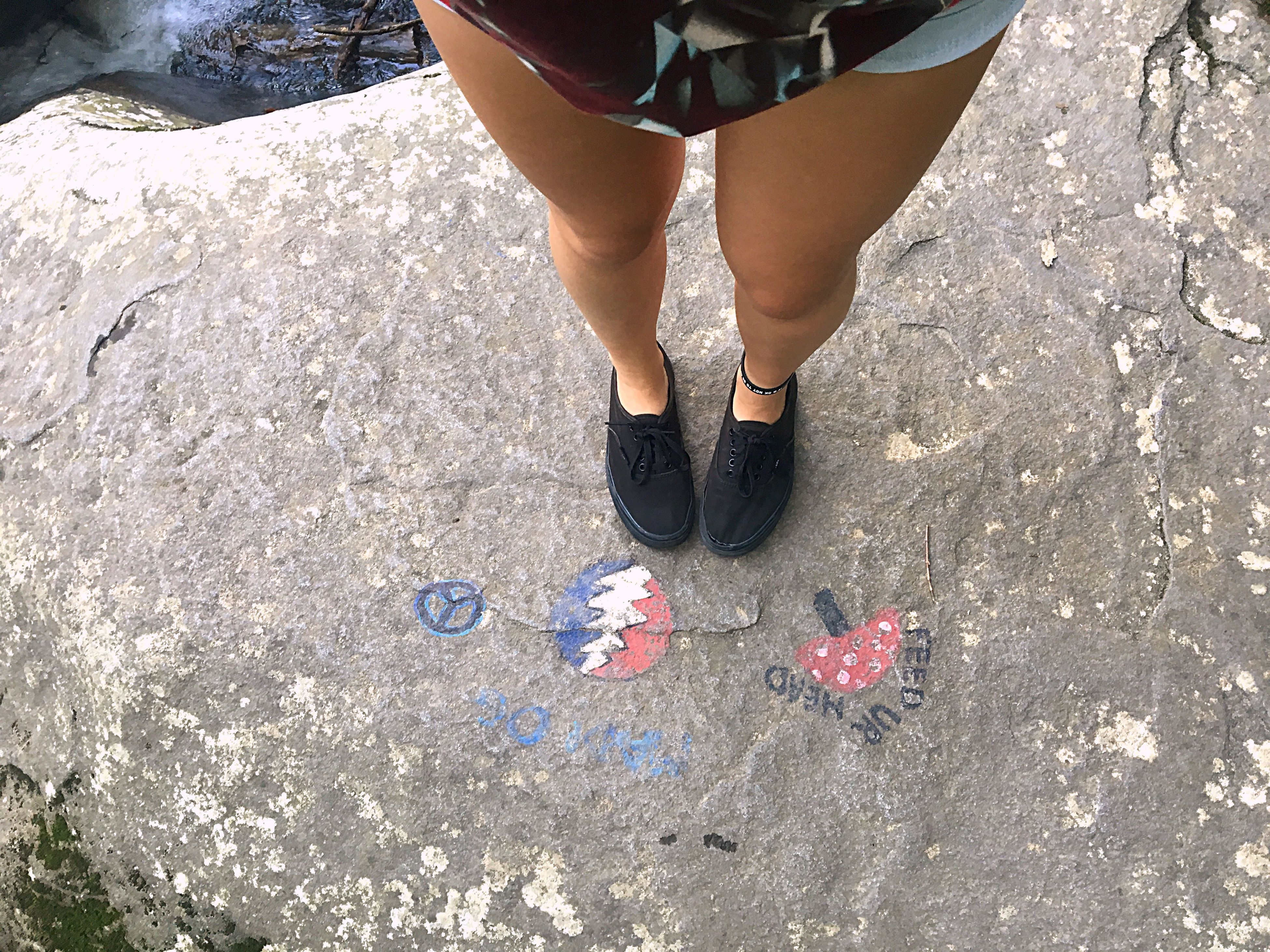 low section, person, lifestyles, human foot, standing, leisure activity, footwear, casual clothing, day, outdoors, unrecognizable person, part of, ground