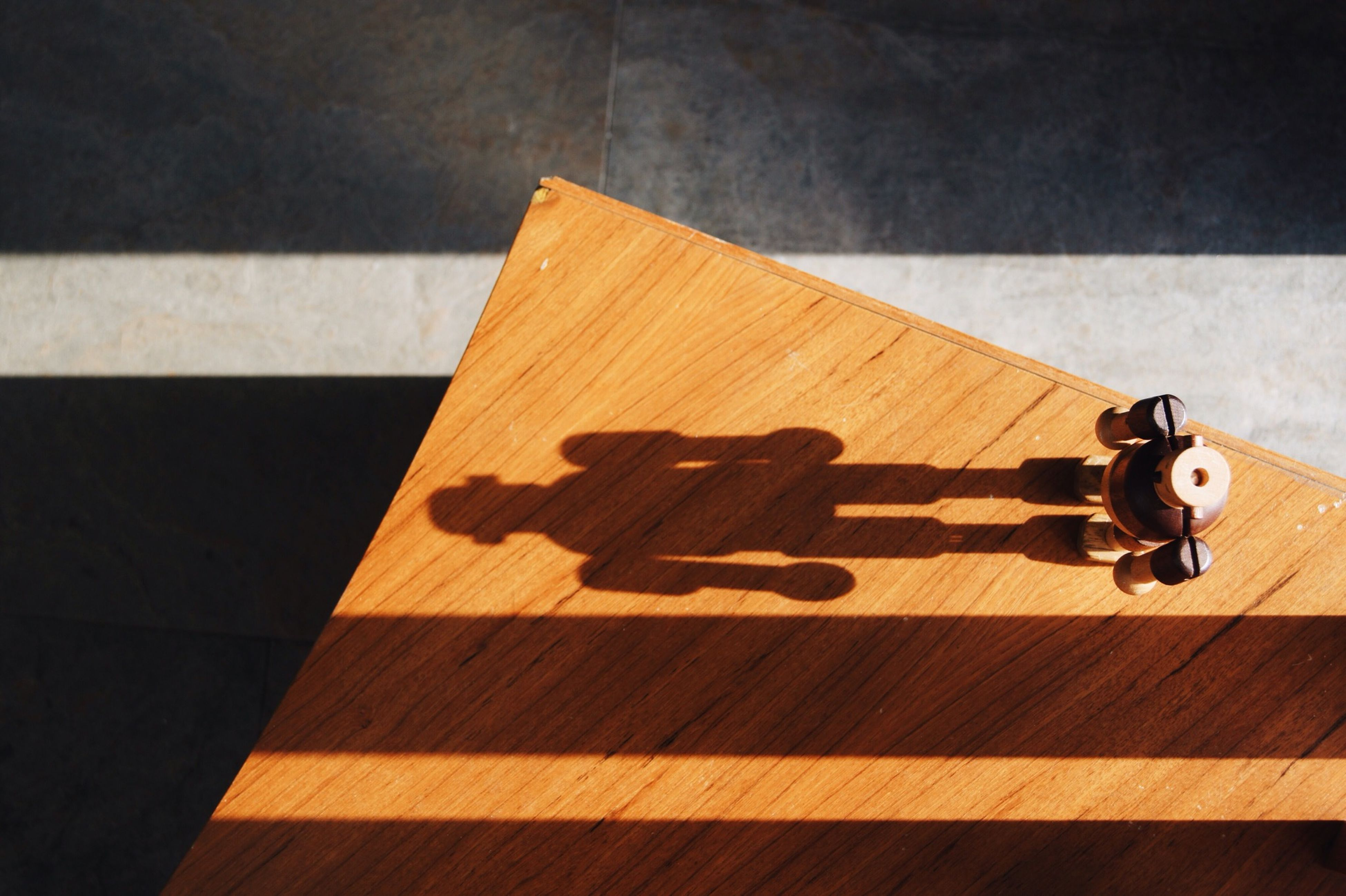 high angle view, wood - material, wooden, indoors, shadow, table, flooring, wood, bench, still life, no people, hardwood floor, sunlight, sidewalk, wall - building feature, plank, elevated view, day, floor