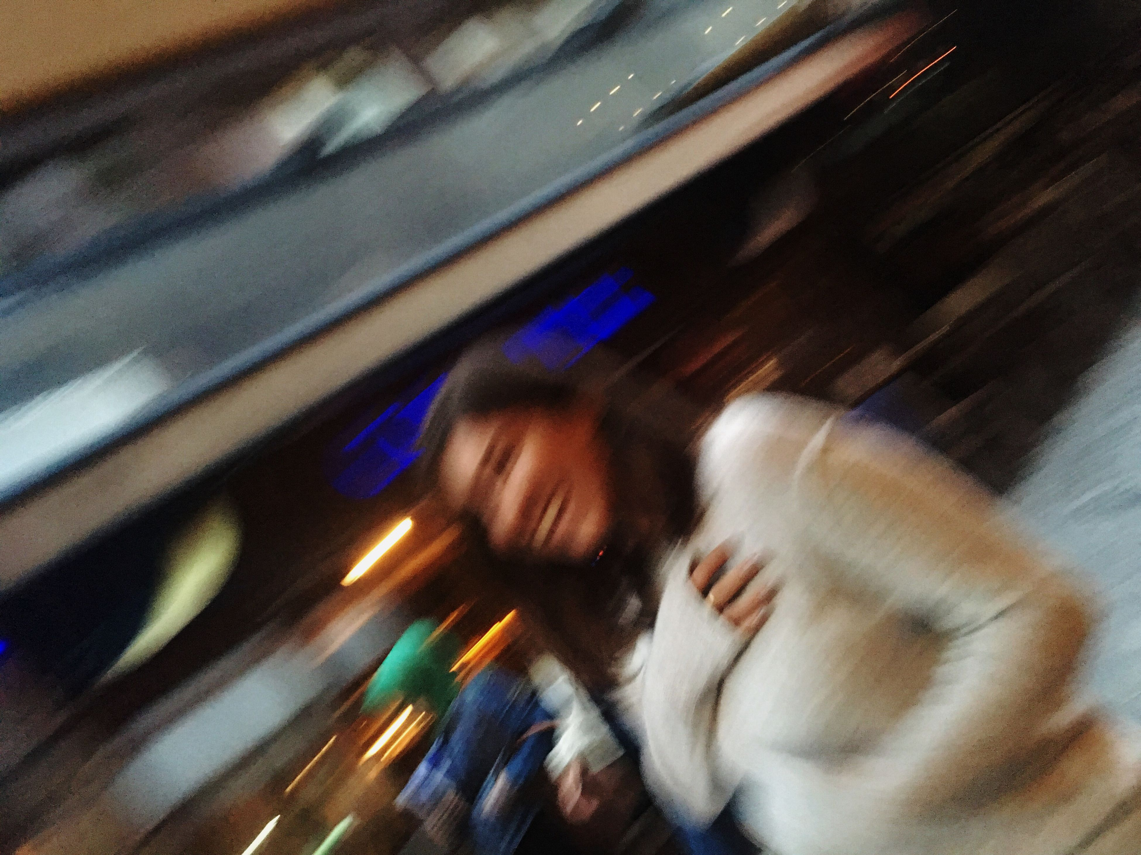 lifestyles, indoors, window, leisure activity, blurred motion, reflection, illuminated, person, looking