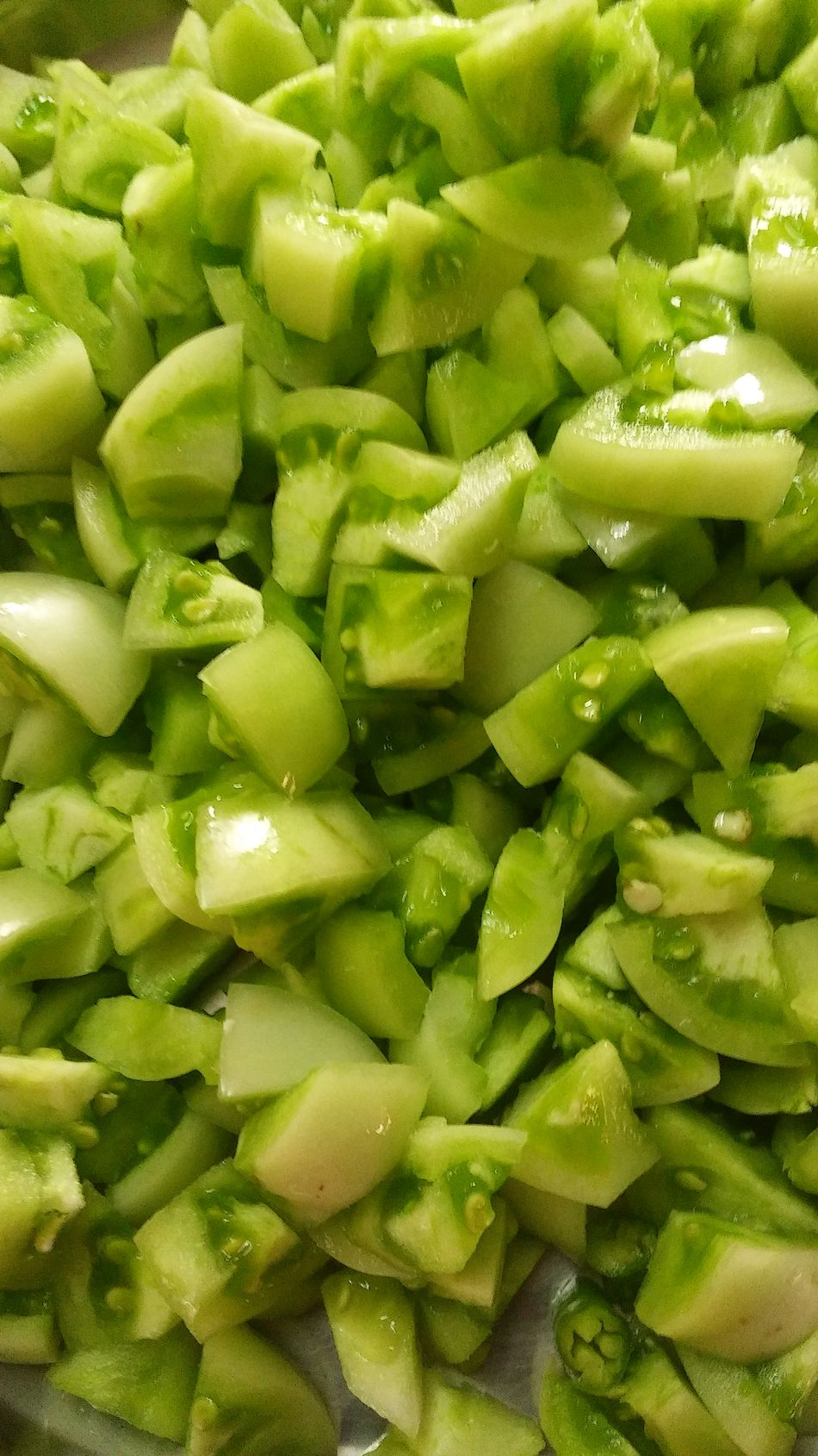 Green Color Food Backgrounds Food And Drink Healthy Eating No People Freshness Full Frame Close-up Day Skinny Tomatoes Unpeeled Tomatoes Tomatoes With Seeds Green Tomatoes Raw Tomatoes Chopped Chopped Raw Tomatoes Freshness Green Color Hand Cutting Hand Work Indoor