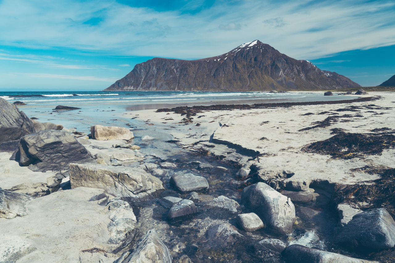 Flakstad beach and mountain at midday in Lofoten. Norway. Beach Flakstad Lofoten Norway Ocean Landscape Travel Destinations Outdoors No People Nature Beauty In Nature Scenics Tranquil Scene Clear Sky Day