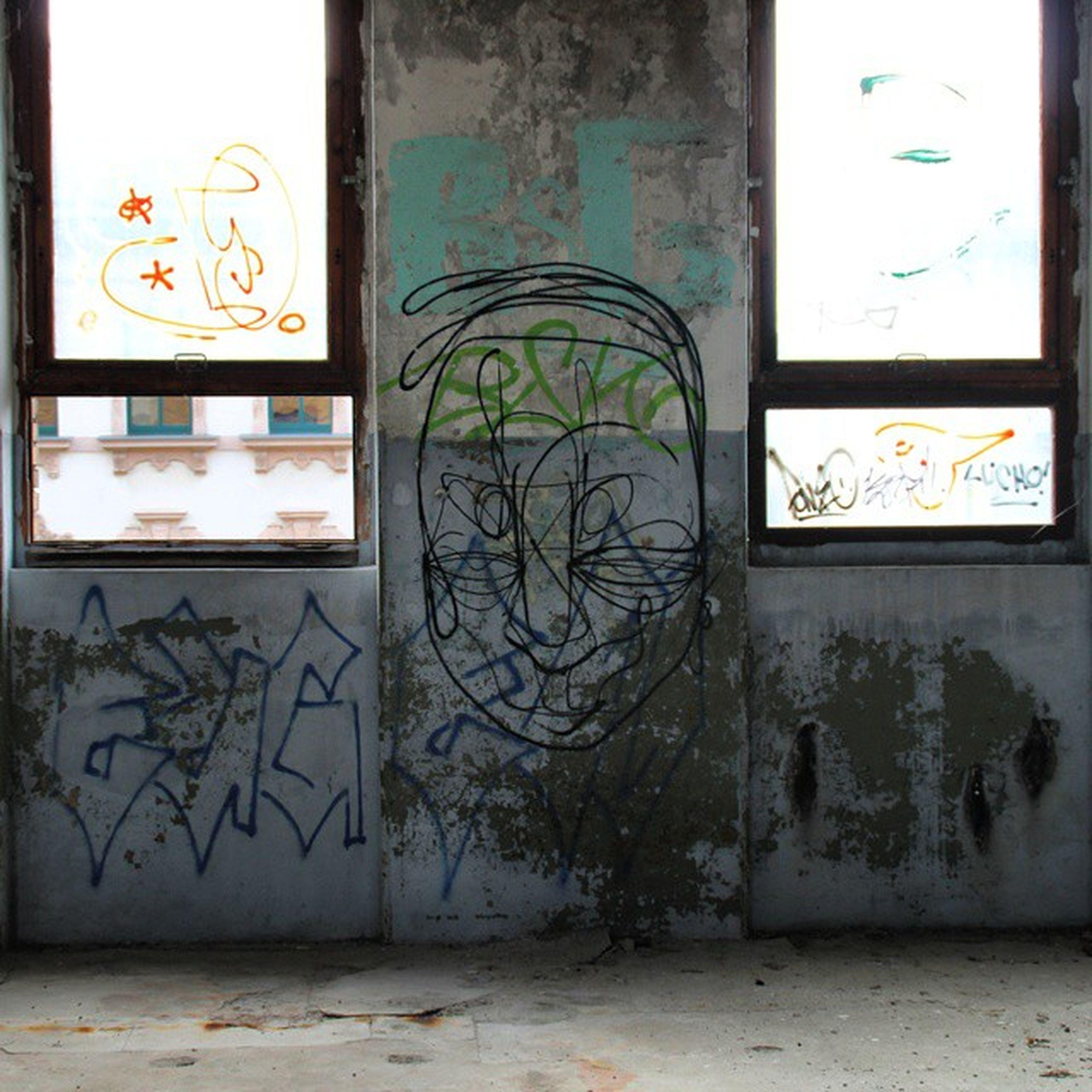 graffiti, art, art and craft, creativity, wall - building feature, built structure, architecture, wall, building exterior, street art, text, door, mural, human representation, multi colored, western script, window, design, animal representation, closed