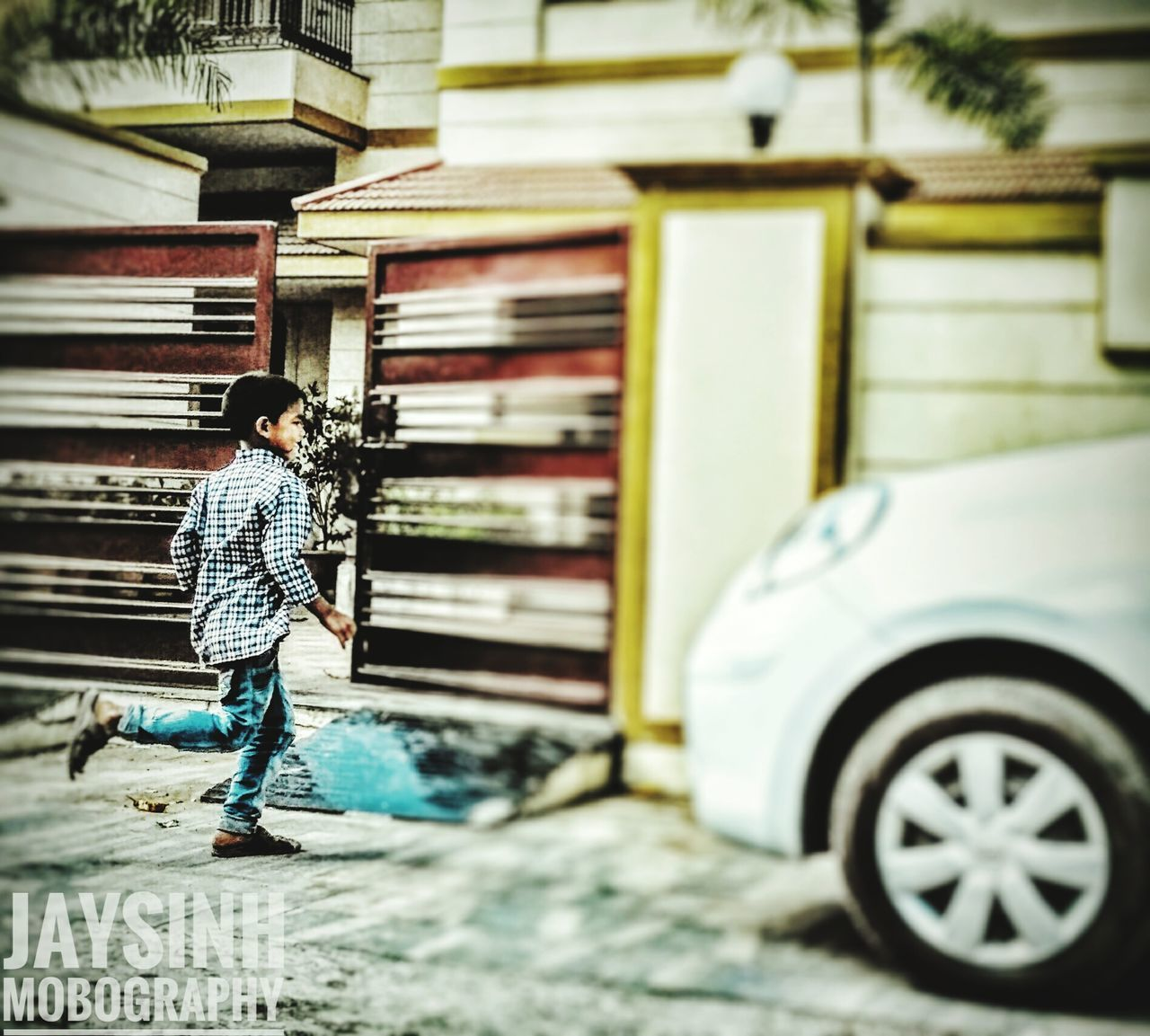 real people, full length, one person, casual clothing, architecture, transportation, mode of transport, built structure, lifestyles, land vehicle, outdoors, building exterior, day, standing, men, women, young adult, adult, people