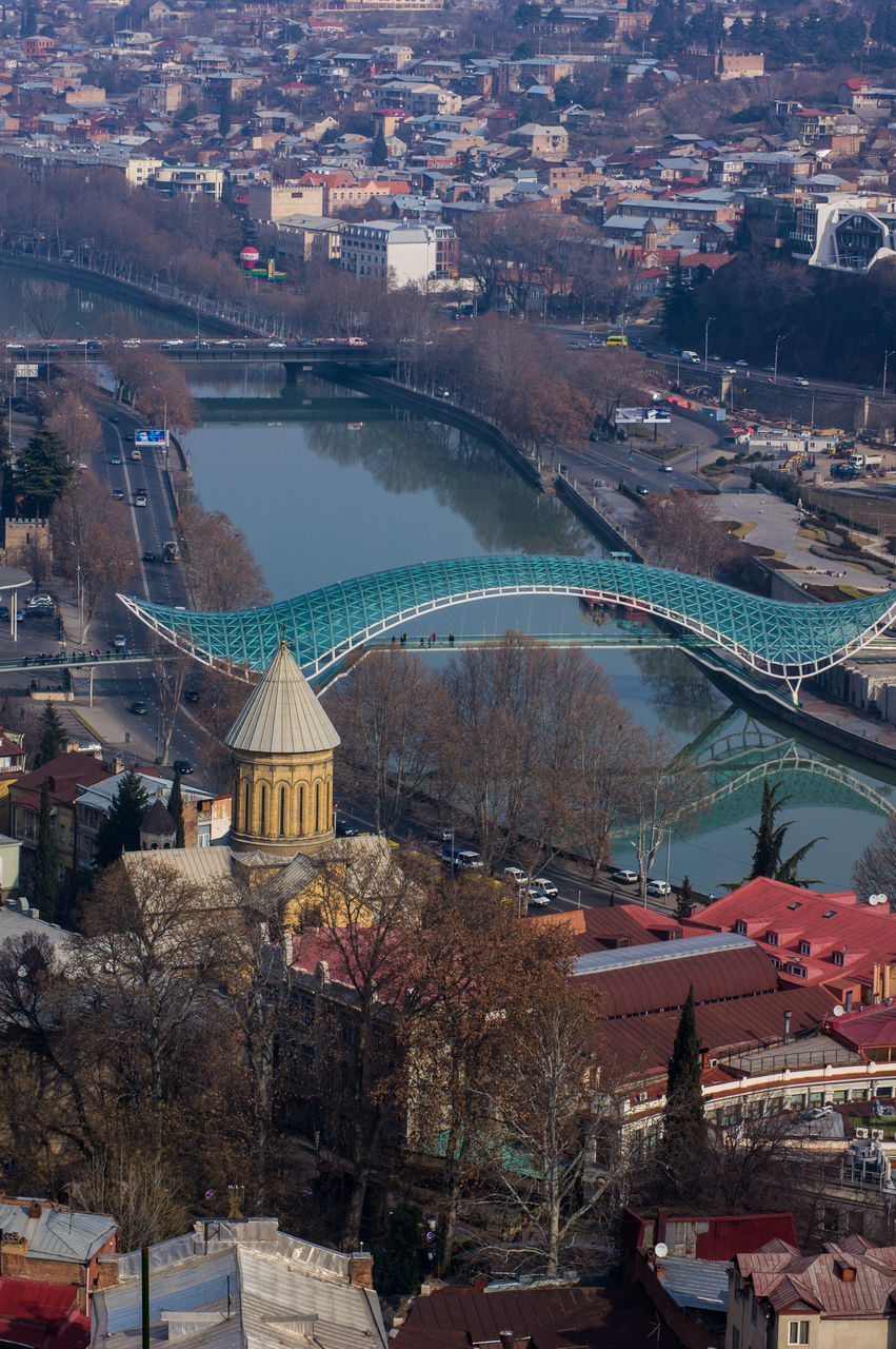 architecture, built structure, building exterior, city, cityscape, high angle view, travel destinations, tree, river, outdoors, day, no people, bridge - man made structure, aerial view, nature, water, beauty in nature