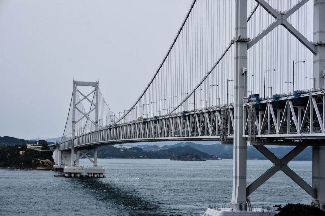 Architecture Bridge - Man Made Structure Built Structure Business Finance And Industry Cable Connection Day Engineering Nature No People Outdoors Sea Sky Steel Cable Suspension Bridge Transportation Travel Travel Destinations Water