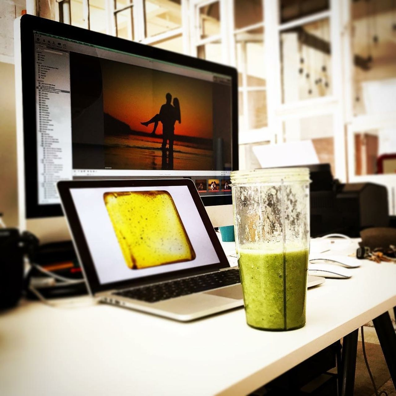 Desks From Above Working IMac27 MacBook Pro Office Photographer First Eyeem Photo Couples❤❤❤ Couple Love Work Place Raw Vegan Food Raw Coctail Spinach Banana Apple Oldwindow Window Wall Photostudio Photographer Office Energydrink Work Table Daydreaming I Love My Work
