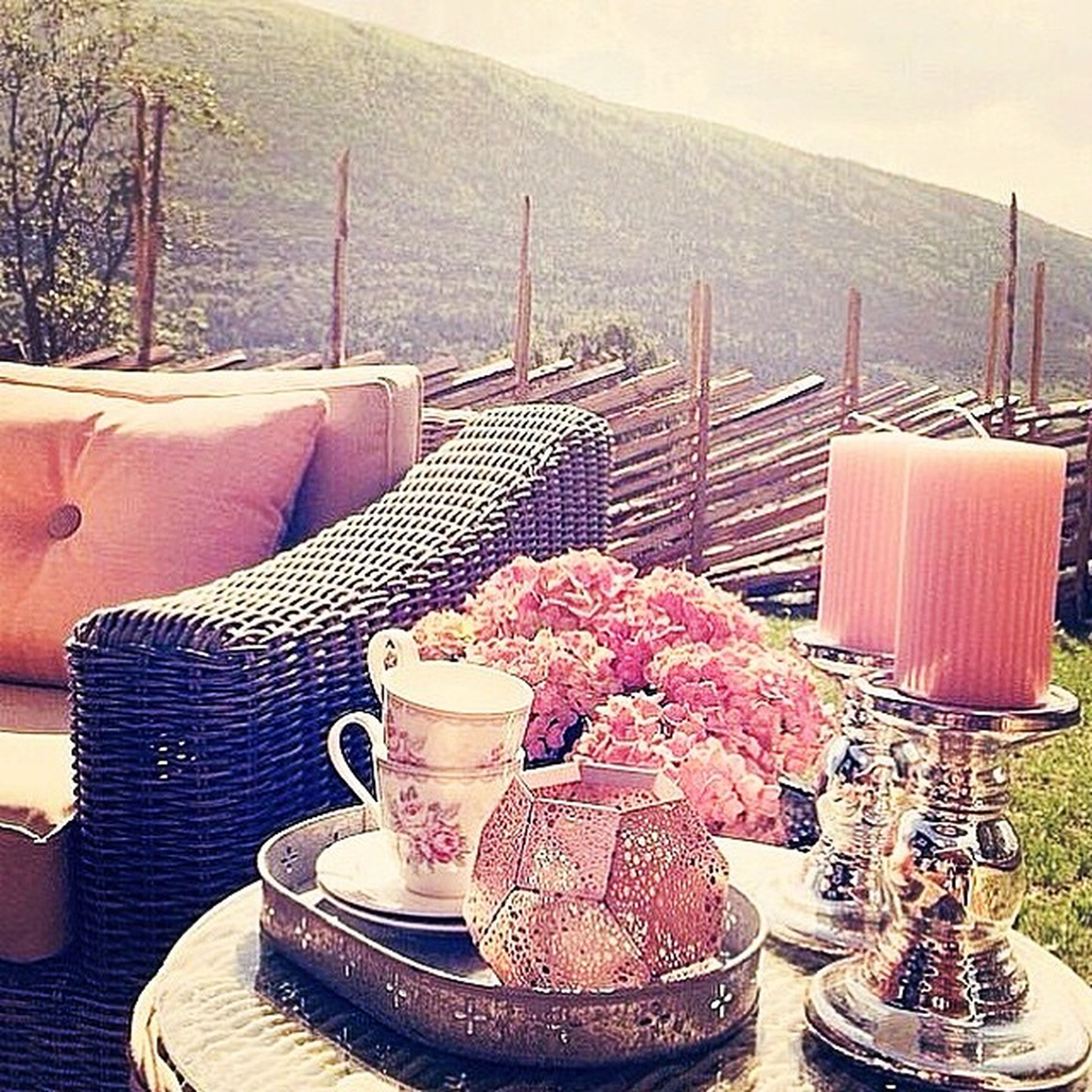chair, table, freshness, flower, built structure, mountain, day, nature, high angle view, house, architecture, building exterior, roof, tree, outdoors, basket, no people, plant, absence, railing