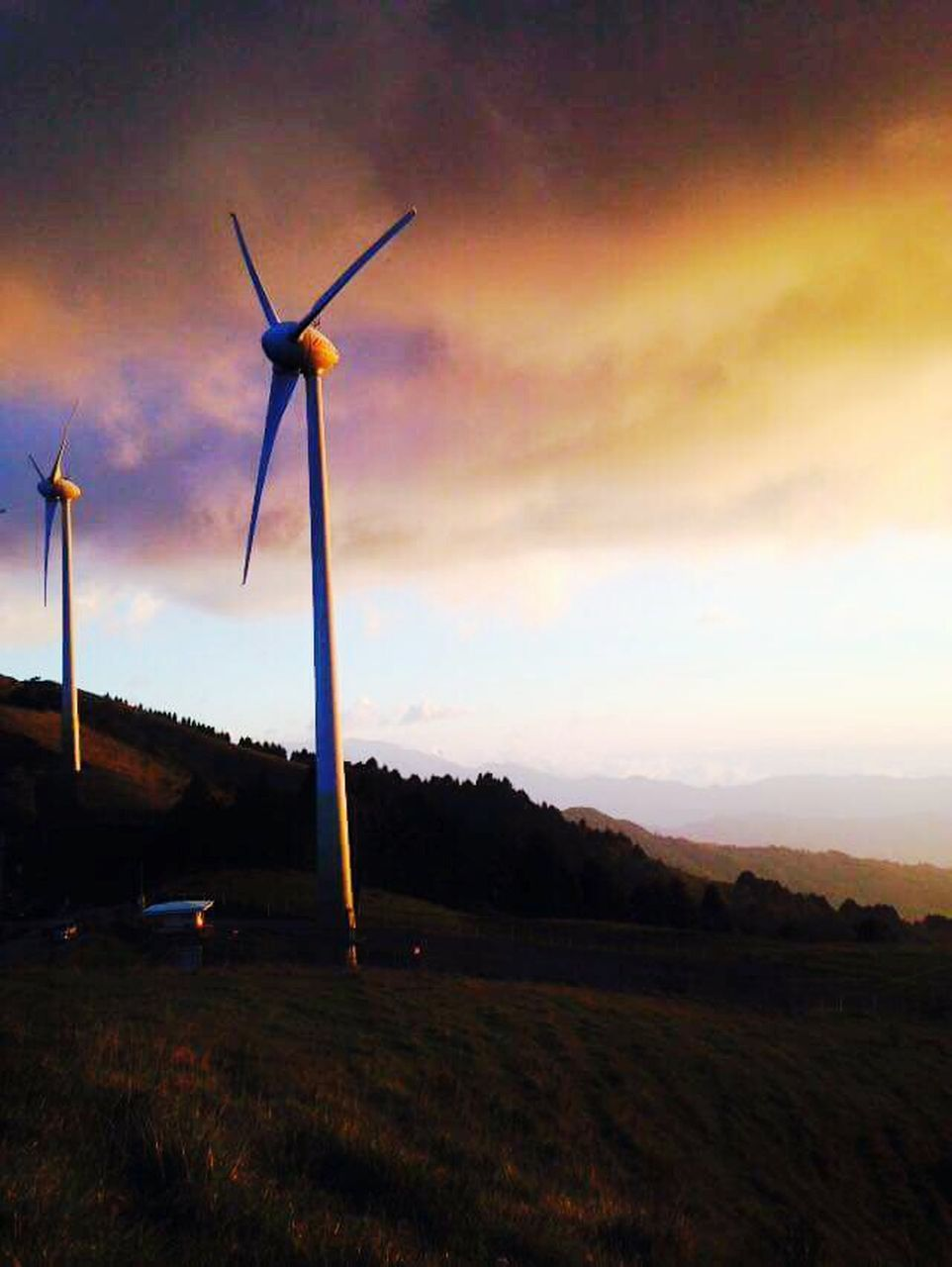 alternative energy, environmental conservation, wind power, wind turbine, fuel and power generation, renewable energy, windmill, sunset, industrial windmill, outdoors, nature, cloud - sky, sky, no people, field, tranquility, grass, technology, beauty in nature, scenics, landscape, rural scene, day