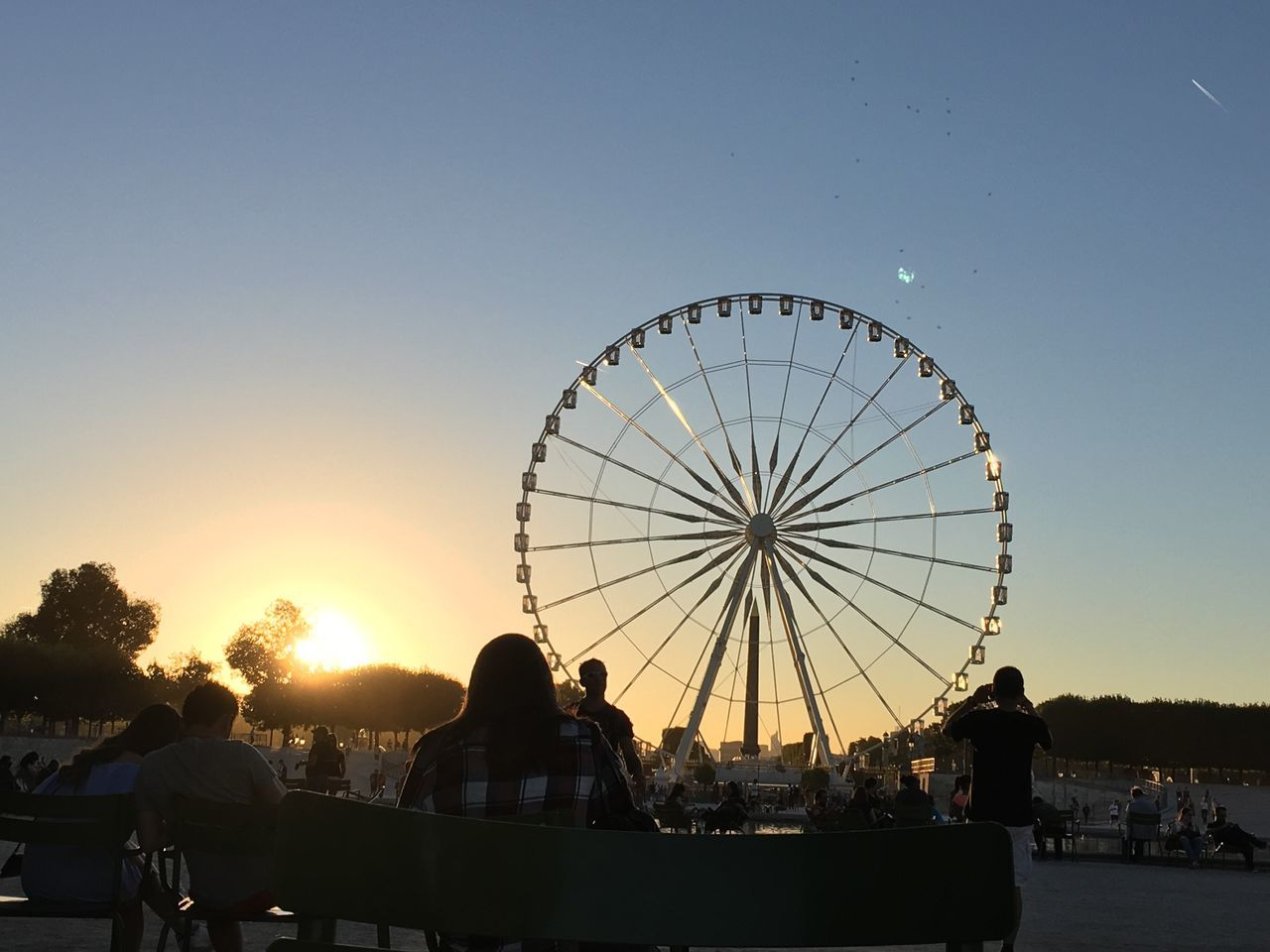 Sunny afternoons at the Tuileries 😌🎡🌅 My Year My View Lazy Afternoon Sunset Tuileries Park Ferris Wheel Sunbathing Enjoying Life Enjoying The Sun Sky Sun People Summer Paris Taking Photos Young Adult Blue Colorful EyeEm Best Shots Eye4photography  EyeEm Gallery Outdoors Relaxing Keep Traveling