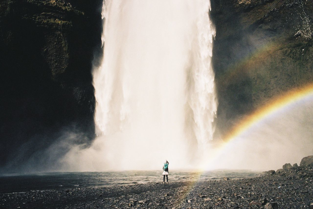 Motion Water Long Exposure Splashing Spraying Waterfall Beauty In Nature Nature Rainbow Outdoors Real People Scenics Power In Nature Day Blurred Motion Speed Rear View Leisure Activity Double Rainbow One Person Iceland Waterfalls Film Photography Filmisnotdead TCPM