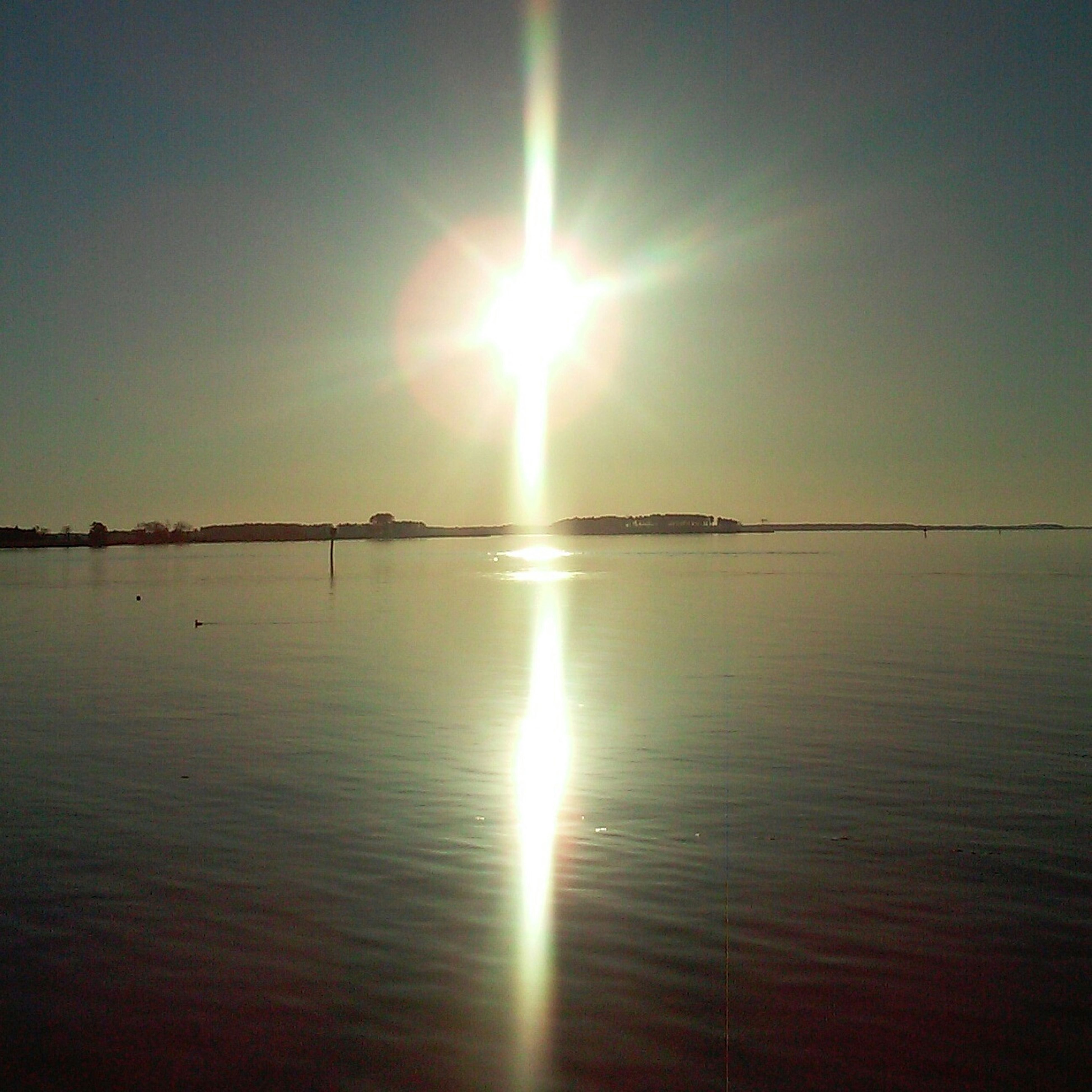 sun, water, reflection, tranquil scene, scenics, tranquility, sea, sunset, beauty in nature, sunlight, sunbeam, horizon over water, lens flare, nature, idyllic, sky, waterfront, bright, rippled, calm