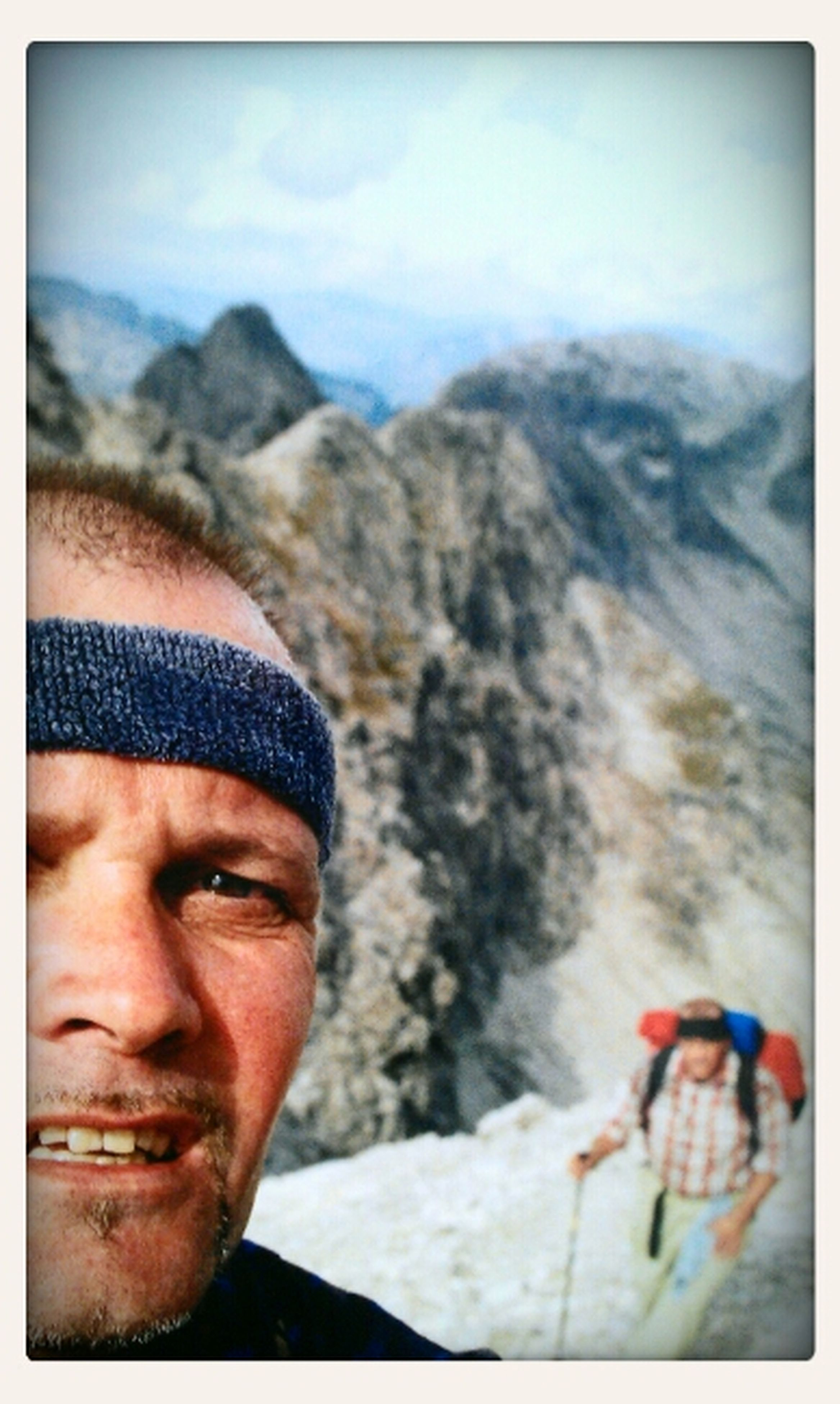 lifestyles, leisure activity, mountain, transfer print, auto post production filter, men, headshot, sky, young men, young adult, adventure, vacations, nature, mountain range, tourist, travel, person, holding