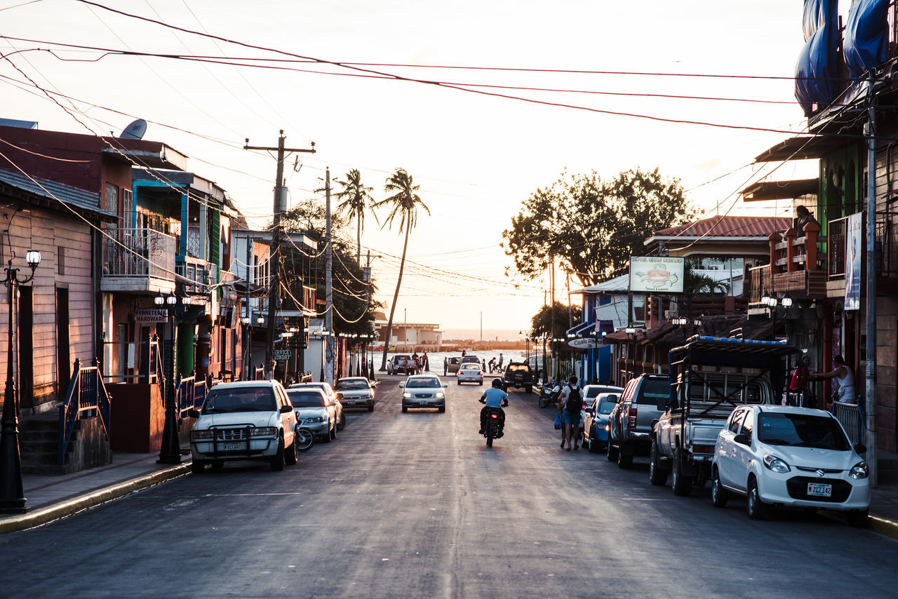 Sun sets in the village Calm Mode Of Transport Nicaragua One Person Outdoors People Relax Road San Juan Del Sur Sky Street Sunset Village