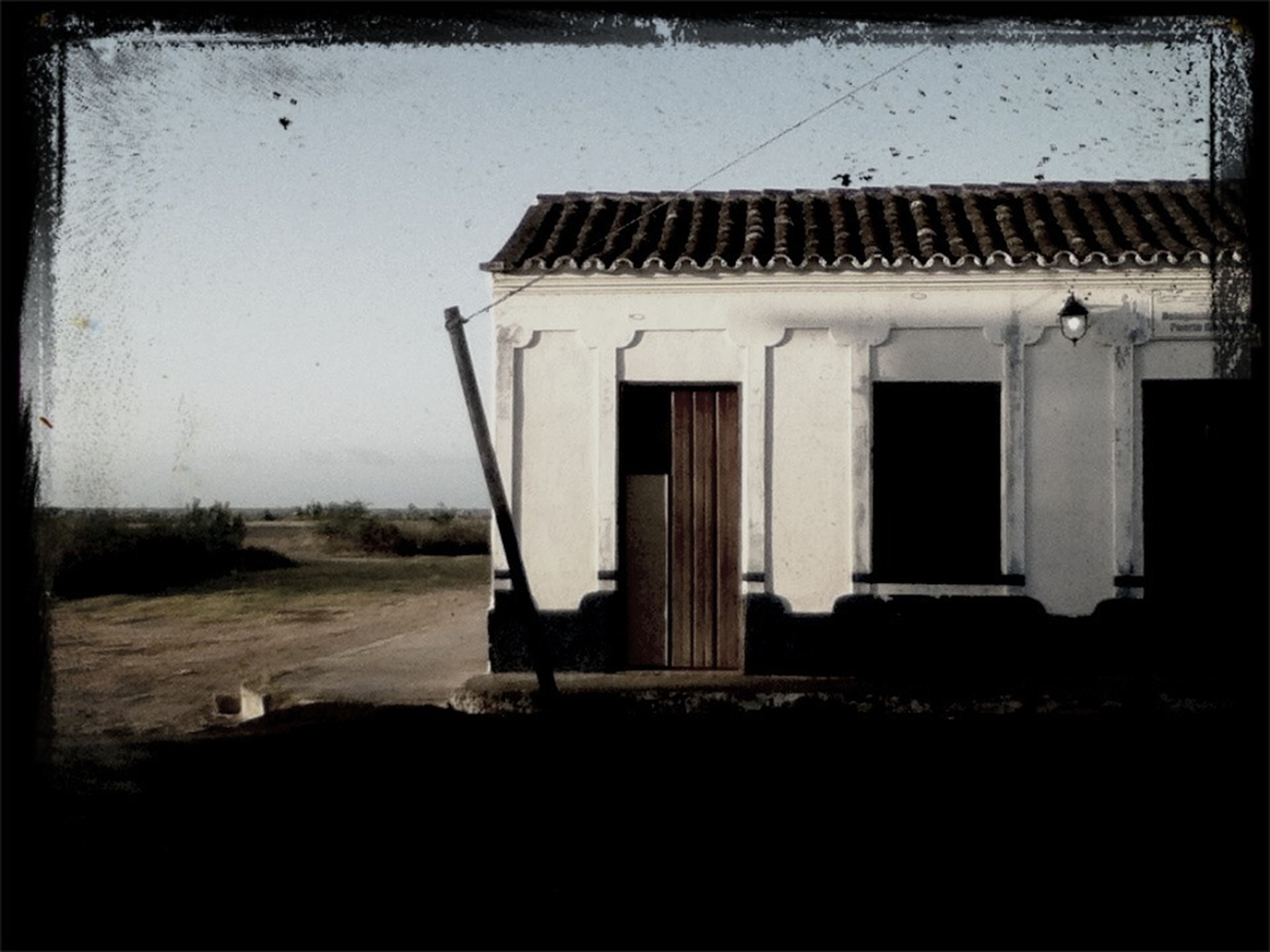 abandoned, built structure, transfer print, architecture, building exterior, auto post production filter, obsolete, damaged, old, run-down, house, clear sky, sand, day, beach, deterioration, outdoors, sky, field, no people