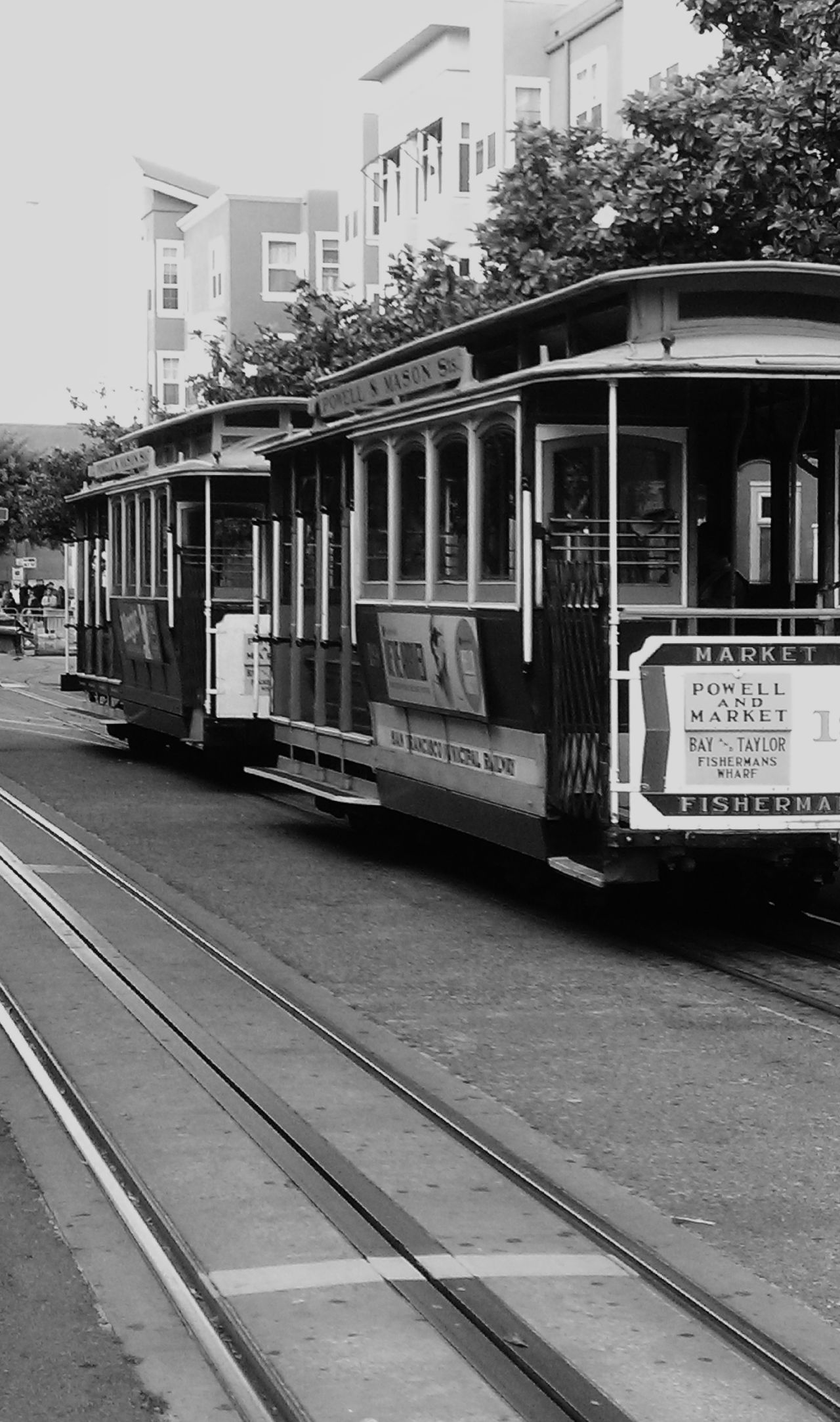 San Francisco City Streets  are bustling as the Trolley goes through the intersection near Fisherman's Wharf Hanging Out Relaxing Taking Photos Travel Photography Road Trip Best Of EyeEm Eye4photography  Original Photography Mobile Photography Monochrome Blackandwhite Photography Urban Lifestyle Urbanphotography California Dreaming Taking Photos Choatephotos Choatgrapy The City Light The City Light The Street Photographer - 2017 EyeEm Awards