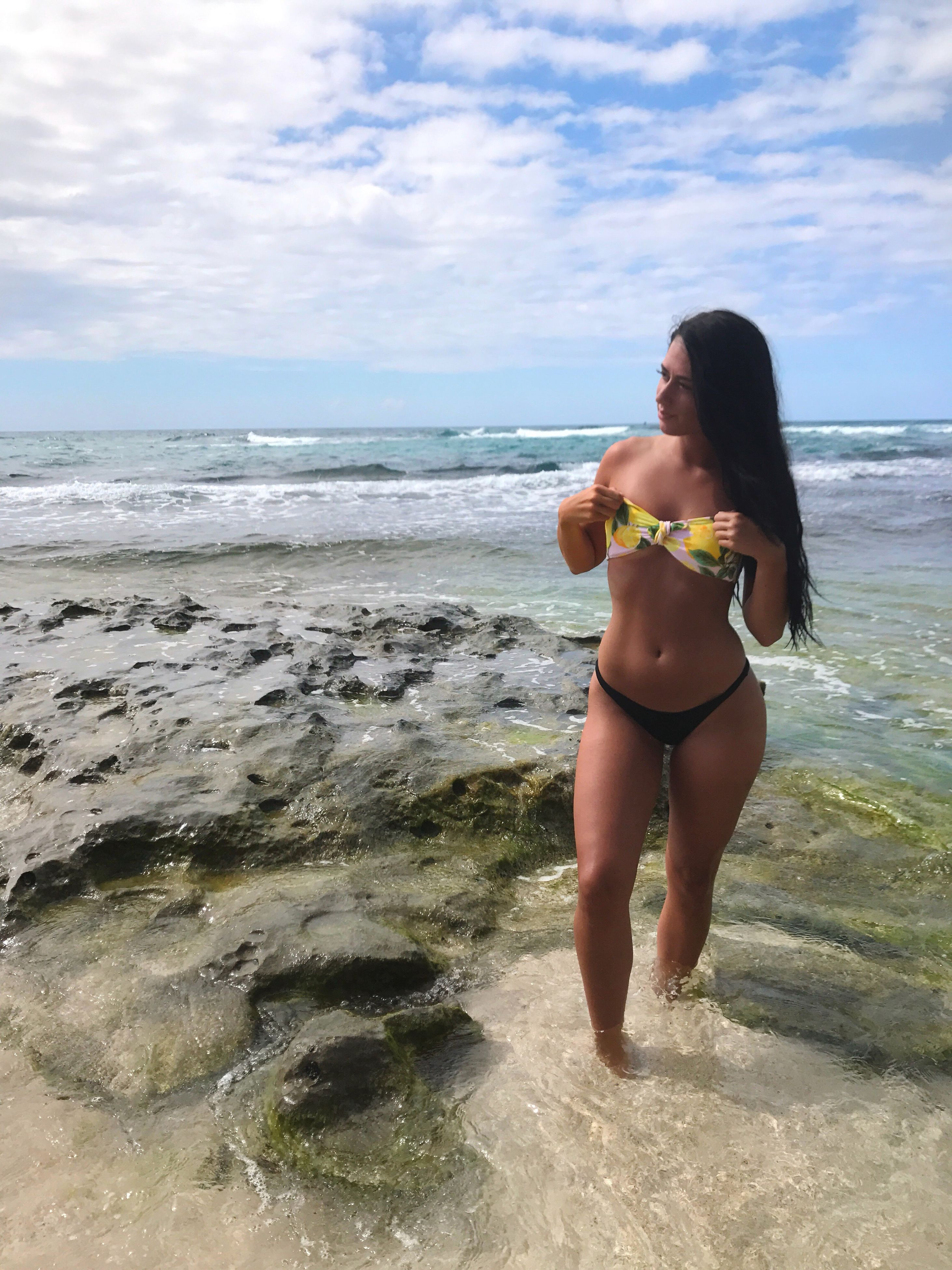 sea, water, sky, beach, one person, nature, real people, beauty in nature, leisure activity, horizon over water, bikini, young adult, young women, standing, full length, scenics, cloud - sky, lifestyles, day, outdoors, beautiful woman, vacations