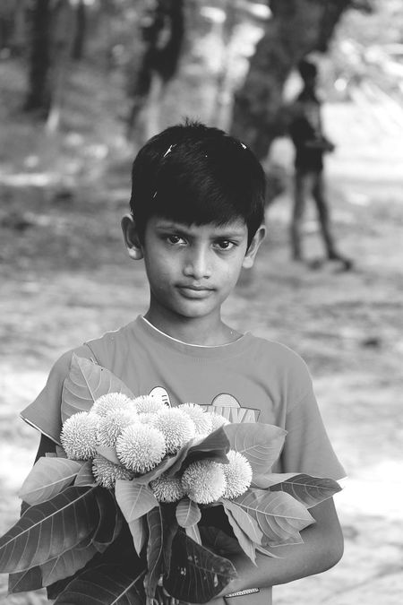 The Portraitist - 2017 EyeEm Awards First Eyeem Photo Adult Real People Tree Trunk Day Nature Beauty In Nature The Way Forward People Outdoors Tree Only Men Adults Only One Person Bicycle Transportation Road City The Street Photographer - 2017 EyeEm Awards Live For The Story FLOWER BOY! Cute Innocence