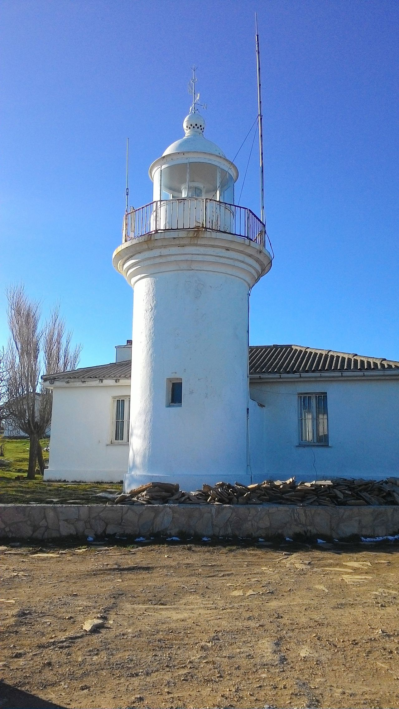 Protection Building Exterior Lighthouse Architecture Safety Tower Security Sky Built Structure Beach Lookout Tower Prison Travel Destinations Day Business Finance And Industry No People Sea Security System Outdoors Clear Sky