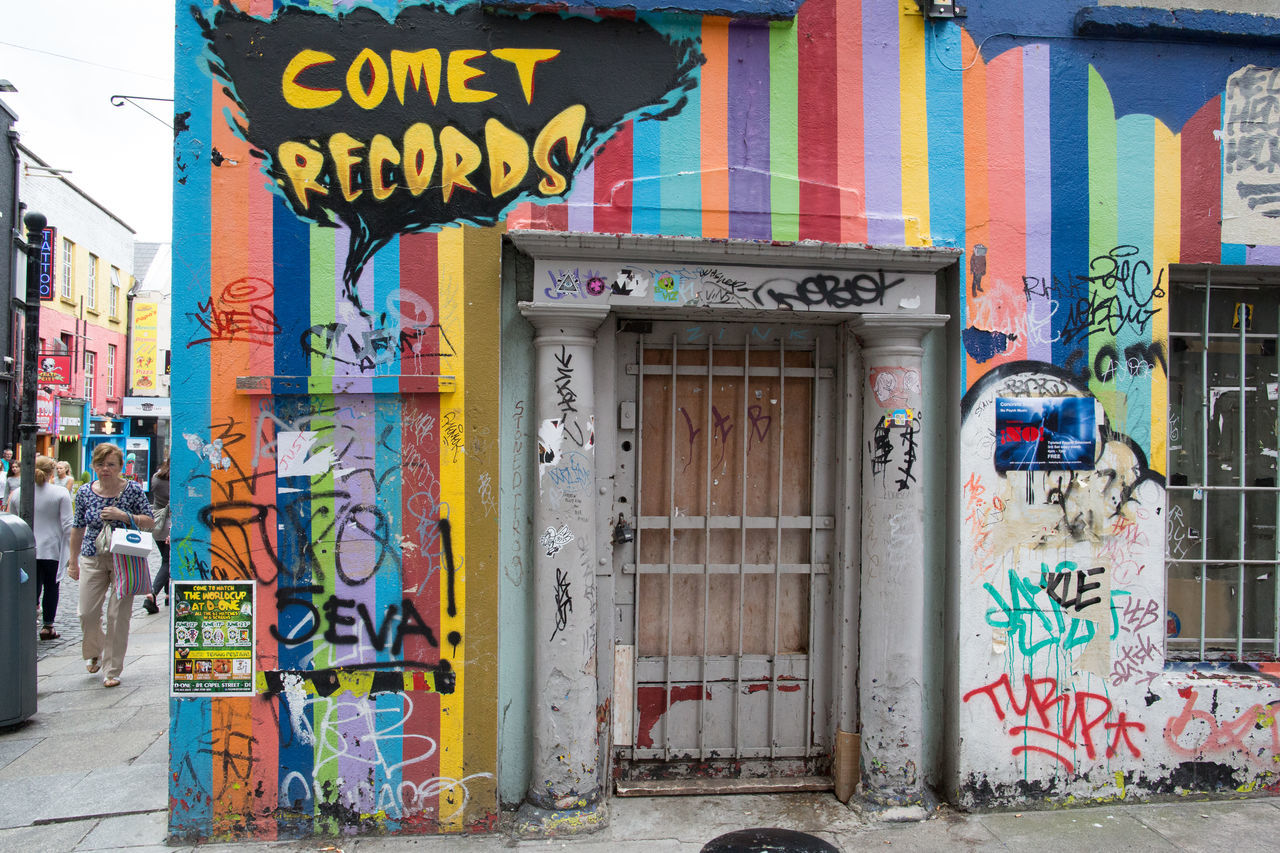 graffiti, text, multi colored, architecture, built structure, building exterior, communication, day, outdoors, no people