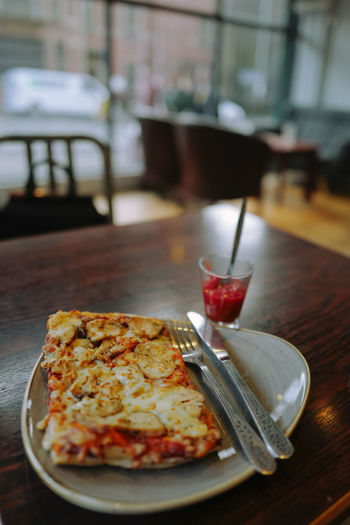 A pizza for one served on a table Close-up Day Drink Food Food And Drink Food For One Freshness Indoors  Ketchup No People Pizza Ready-to-eat Sand Table