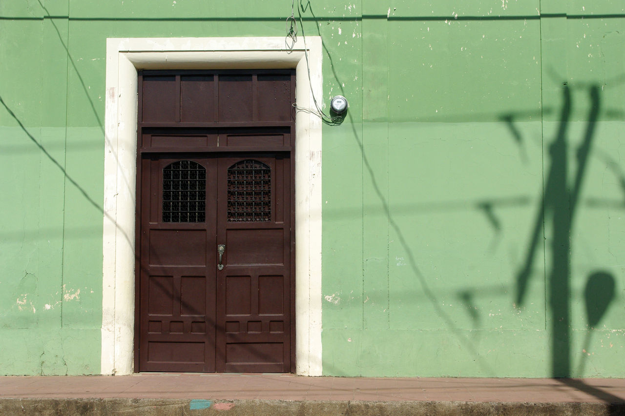 Architecture Brown Door Closed Colonial Door Entrance Green Wall No People Shadow