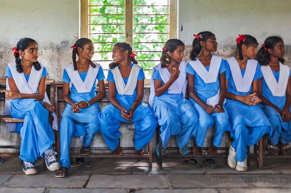 Girls of a school in Wardha, Maharashtra India Wardha Maharashtra Lifestyles Leisure Activity Sitting Togetherness Friendship Full Length Casual Clothing Front View Person Young Adult Looking Person Day