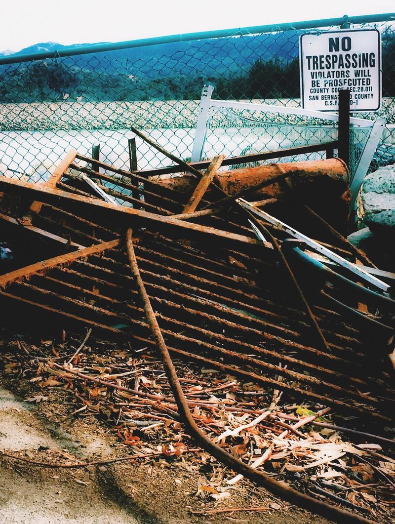 Junk Scrap Iron Trash Litter No People Day Outdoors Sea Sky Water Architecture Nature Fence Lake Near Water Refuse EyeEm Best Shots
