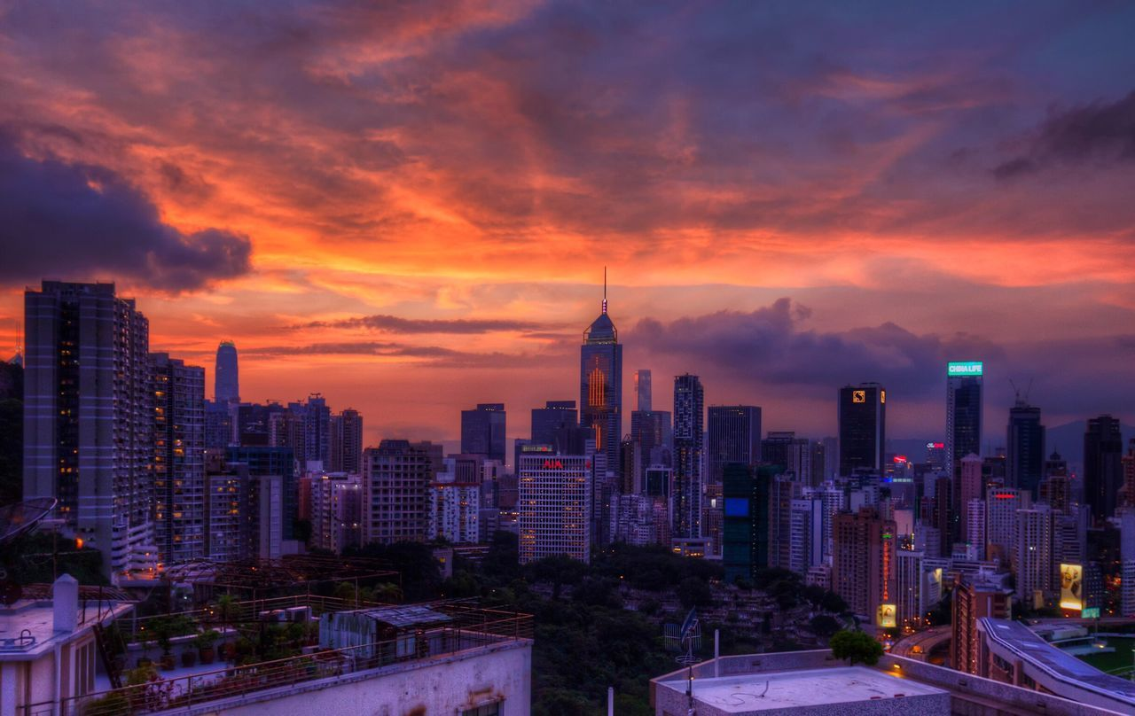 Modern Buildings Against Orange Cloudy Sky During Sunset In City