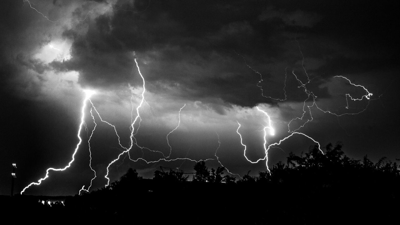 Beauty In Nature Cloud - Sky Danger Dramatic Sky Electricity  Forked Lightning Illuminated Lightning Low Angle View Nature Night No People Outdoors Power In Nature Scenics Silhouette Sky Storm Storm Cloud Thunderstorm Tree Weather