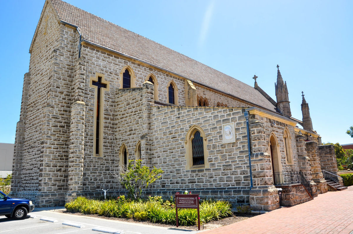 Rear view of St. Patrick's Basilica with limestone federation gothic architecture in historic Fremantle, Western Australia. Arched Architecture Basilica Brick Building Exterior Buttress Cathedral Catholic Chapel Church Cross Day Façade Federation Gothic Fremantle, Western Australia Gothic Historic Limestone Old Outdoors Place Of Worship Rear View Spiritual St. Patrick's Day Windows
