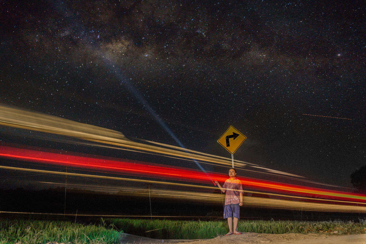 going right? Transportation Light Trail Long Exposure Night Speed Illuminated Sky Scenics Tranquil Scene Outdoors Nature Star Field Astronomy Beauty In Nature Majestic Galaxy Tranquility Non-urban Scene Sign Board Street Overnight Success