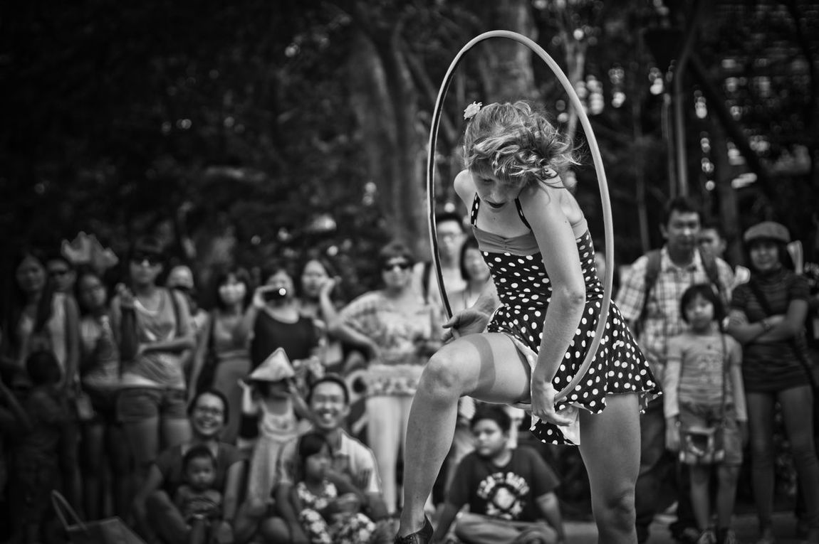 Buskers Festival Performance Outdoors Performing Arts Event People Adult Day Bokeh Blackandwhite Photography Black & White Blackandwhite Polkadots Hoola Hoop Buskersfestival Busker Young Adult Light And Shadow Standing Beauty The Street Photographer - 2017 EyeEm Awards